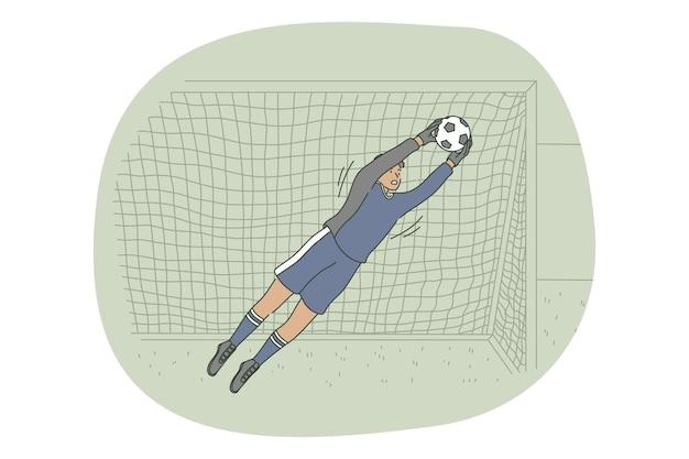 Jugador portero atrapando la pelota en el campo durante el entrenamiento o el juego