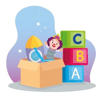 Juguetes para niños, alfabeto de cubos y juguetes en la caja de cartón