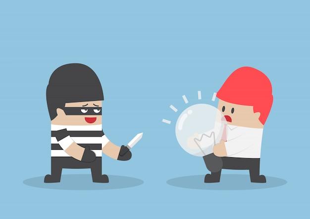Ladrón robando bombilla de idea de empresario
