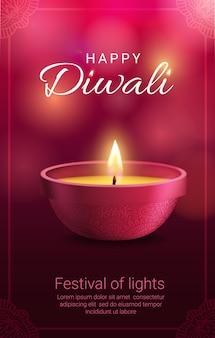 Lámpara diwali diya con marco de decoración rangoli.