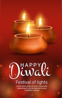 Lámparas de oro diya con rangoli de flores, festival de luces de diwali de la religión hindú india.