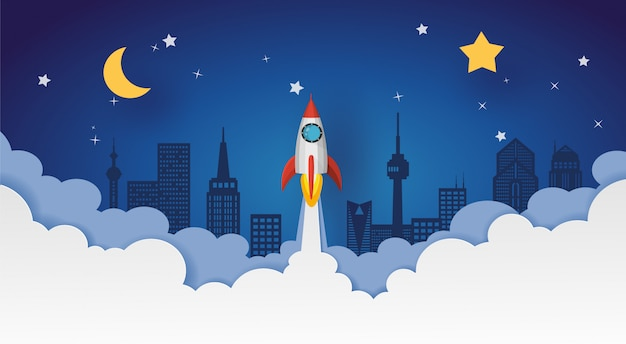 Lanzamiento de un cohete al cielo nocturno sobre la ciudad con luna y estrellas. diseño vectorial en corte de papel.