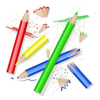 Lápices de colores y cáscaras sobre blanco