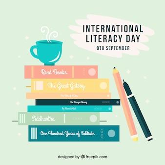 Lápices y libros en estilo plano para el día de la alfabetización