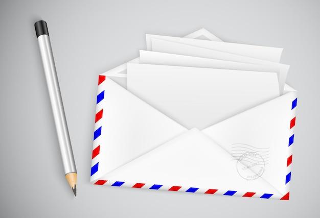 Lápiz y carta con ilustración de sobre