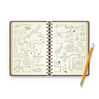 Lápiz y cuaderno abierto con flechas pintadas.