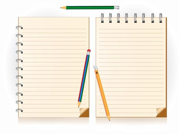 Lápiz y cuaderno en el fondo blanco