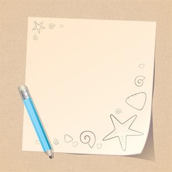 Lápiz y nota de papel en la playa