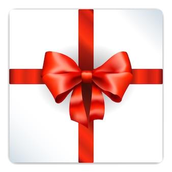 Lazo rojo en caja de regalo plateada