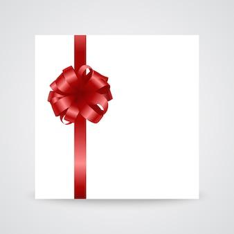Lazo de satén rojo brillante con cinta sobre fondo blanco.