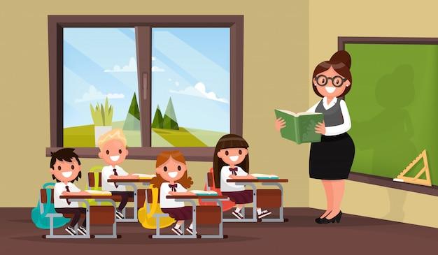 Lección. un profesor con alumnos en el aula de la escuela primaria.