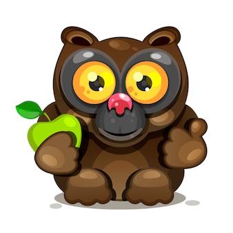 Lemur con grandes ojos se sienta y sostiene una manzana.