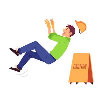 Lesión laboral de un hombre constructor, un trabajador en un casco se resbala y cae sobre un piso resbaladizo.