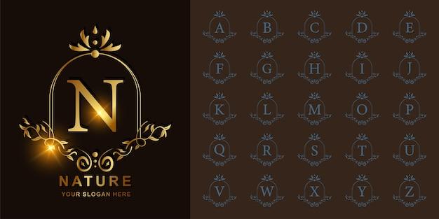 Letra n o alfabeto inicial de colección con plantilla de logotipo dorado de marco floral de adorno de lujo.