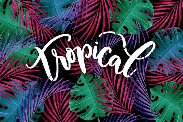 Letras de coloridas hojas tropicales