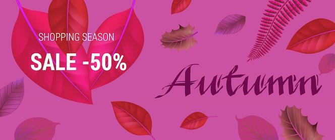 Letras de otoño sobre fondo rosa. venta de temporada comercial cincuenta por ciento letras con hojas