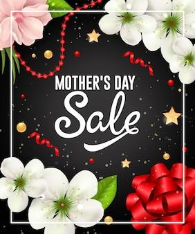 Letras de venta de día de madre en marco con guirnalda y flores.