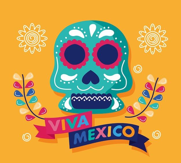 Letras del día de celebración de viva mexico con cabeza de calavera y flores