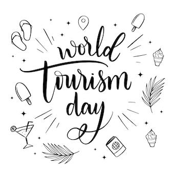 Letras del día mundial del turismo con elementos de playa.