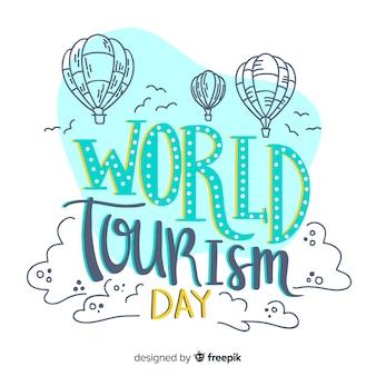 Letras del día mundial del turismo con globos aerostáticos