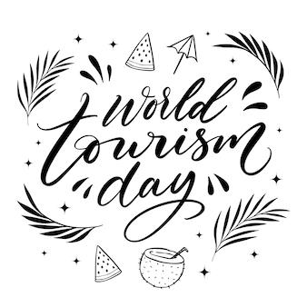 Letras del día mundial del turismo con hojas.