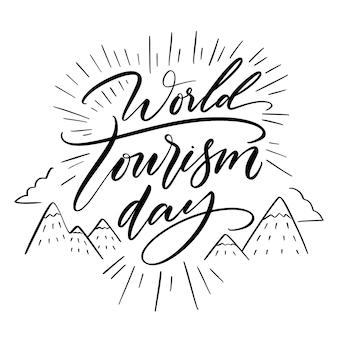 Letras del día mundial del turismo con montañas.