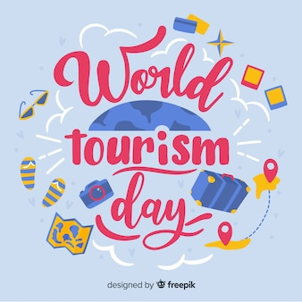 Letras del día mundial del turismo con objetos de viaje