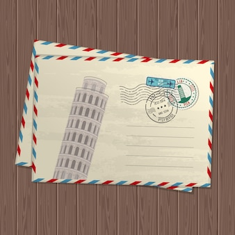 Letras de estilo vintage con la torre inclinada de pisa, marcas y sellos de italia y lugar para el texto sobre textura de madera