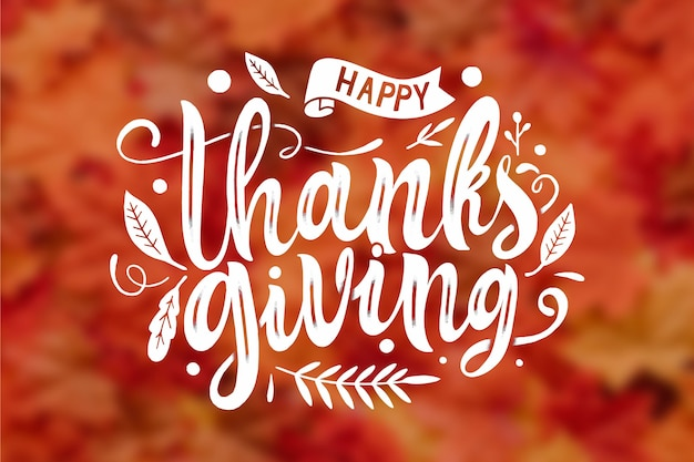Letras de feliz acción de gracias sobre fondo borroso