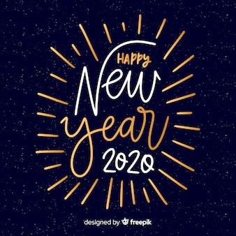 Letras feliz año nuevo 2020 en fuente de colores blanco y dorado
