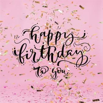Letras de feliz cumpleaños con confeti dorado