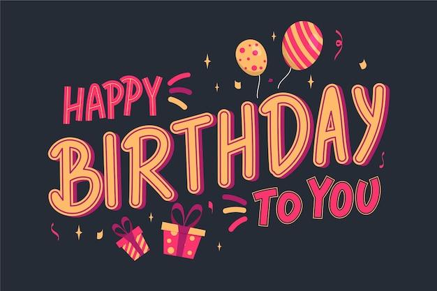 Letras de feliz cumpleaños con globos y regalos