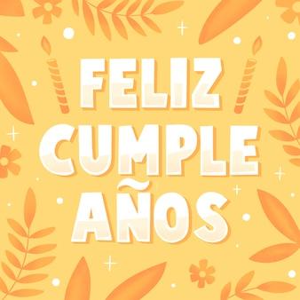 Letras de feliz cumpleaños con hojas y flores.