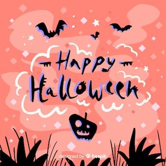 Letras de feliz halloween con fondo rosa