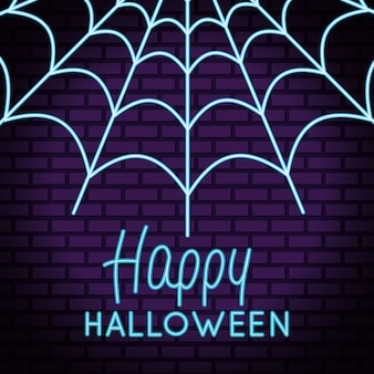 Letras de feliz halloween en luz de neón con telaraña