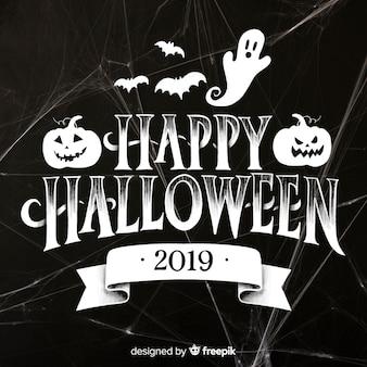 Letras de feliz halloween con tela de araña