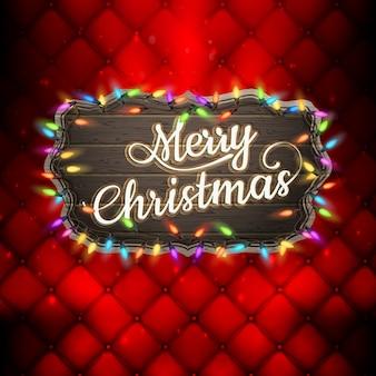 Letras de feliz navidad con luces de guirnalda.