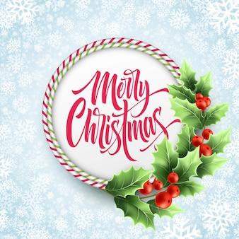 Letras de feliz navidad en marco de bastón de caramelo de círculo. rama de árbol de acebo realista con decoración de frutos rojos. letras de navidad sobre fondo de copos de nieve. plantilla de vector de tarjeta de felicitación de navidad