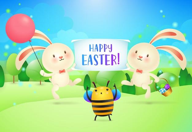 Letras de feliz pascua en banner sostenido por dos conejitos y abejas