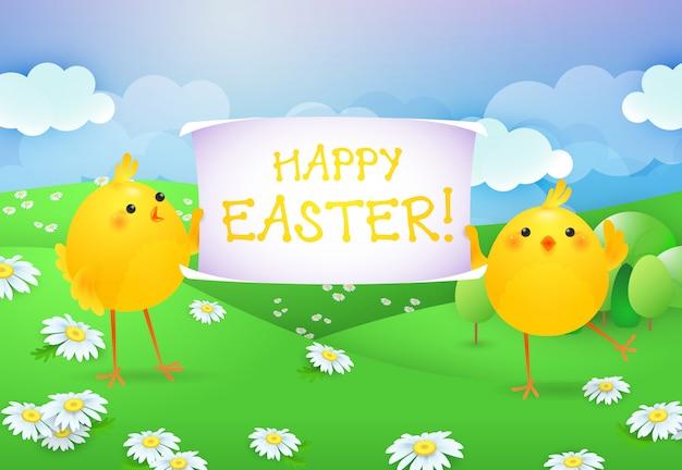 Letras de feliz pascua en banner sostenido por dos polluelos