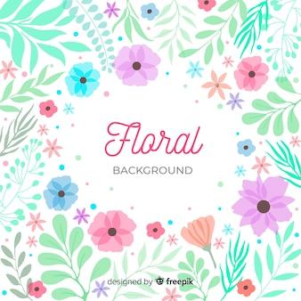 Letras de fondo floral rodeadas de naturaleza