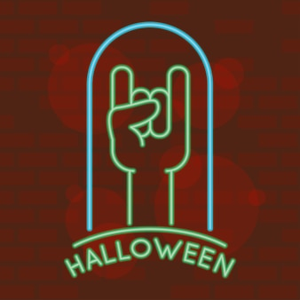 Letras de halloween en luz de neón con símbolo hadn rock and roll