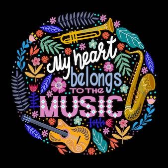 Letras con instrumentos musicales y flores.