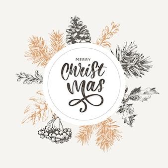 Letras de navidad con ramas de árbol de navidad.