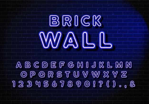 Letras de neón realistas del alfabeto inglés. las letras del alfabeto azul con efecto de brillo azul sobre fondo de pared de ladrillo.