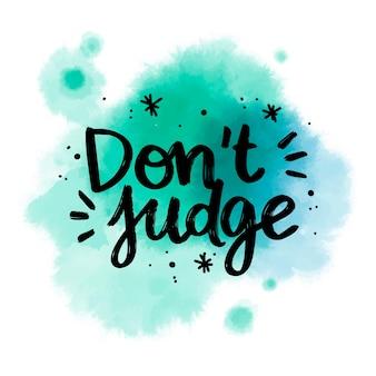 Las letras positivas no juzgan el mensaje en la mancha de acuarela
