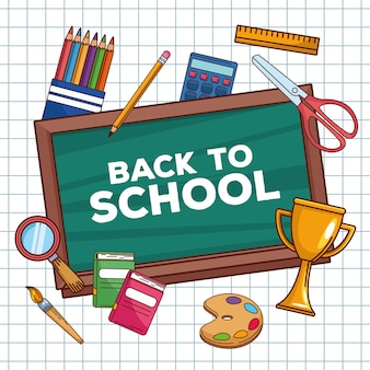 Letras de regreso a la escuela en pizarra con objetos