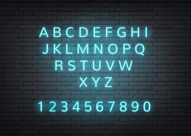 Letras retro alfabeto neón en pared de ladrillo