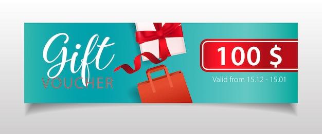 Letras del vale de regalo con caja de regalo y bolsa de compras