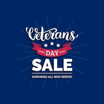 Letras de venta del día de los veteranos con la ilustración de la cinta. fondo de vacaciones del 11 de noviembre. cartel de celebración con estrellas. tarjeta de descuento en.